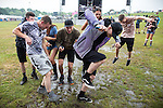 © Joel Goodman - 07973 332324 . 11/06/2016 . Manchester , UK . Revellers dancing in the mud at the Parklife music festival at Heaton Park in Manchester . Photo credit : Joel Goodman