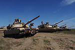 """American soldiers exiting M1A2 Abrams tanks after completing a tank maneuver training exercise where Americans and Danes worked together to simulate battle against opposing forces at the Drawsko Pomorskie Training Area in Poland on June 11, 2015.   NATO is engaged in a multilateral training exercise """"Saber Strike,"""" the first time Poland has hosted such war games, involving the militaries of Canada, Denmark, Germany, Poland, and the United States."""