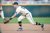 Michigan Wolverines first baseman Jimmy Kerr (15) on defense against the Vanderbilt Commodores during Game 1 of the NCAA College World Series Finals on June 24, 2019 at TD Ameritrade Park in Omaha, Nebraska. Michigan defeated Vanderbilt 7-4. (Andrew Woolley/Four Seam Images)