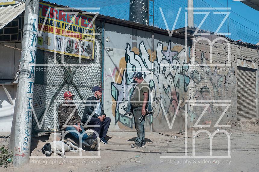 BOGOTA - COLOMBIA, 17-07-2020: Aspecto del Sur de Bogotá durante el día 115 de la cuarentena total obligatoria en el territorio colombiano causada por la pandemia  del Coronavirus, COVID-19. / General view of the daily life in the south of Bogota during the day 115 of mandatory total quarantine in Colombian territory caused by the Coronavirus pandemic, COVID-19. Photo: VizzorImage / Gabriel Aponte / Staff