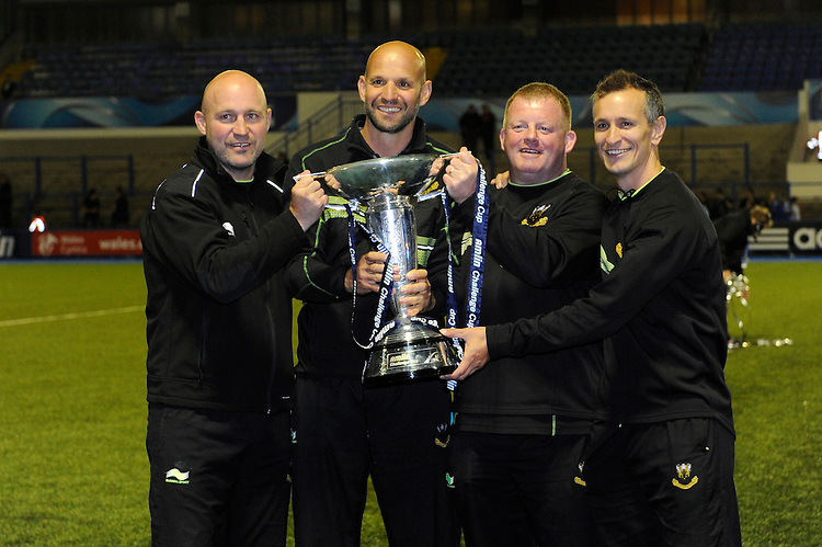 Northampton Saints coaches (L-R) Alex King, Jim Mallinder, Dorian West and Alan Dickens celebrate with the Amlin Challenge Cup trophy at Cardiff Arms Park on Friday 23rd May 2014 (Photo by Rob Munro)