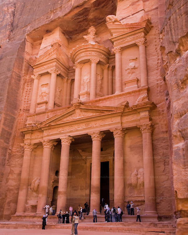 """""""The Treasury,"""" Petra.  The first """"structure"""" encountered after emerging from the Siq into the Nabatean ruins at Petra.  Carved completely by hand from the rock, this structure was probably actually a tomb.  It was dubbed """"the treasury"""" due to a rumor that the Pharoah's gold was hidden in the carved """"urn"""" shape at the top of this facade.  © Rick Collier"""