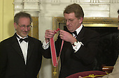 """The British Ambassador, Sir Christopher Meyer KCMG, prepares to confer Honorary Knighthood on film director Steven Spielberg at a ceremony at the British Embassy in Washington, DC on January 29, 2001.  In his remarks the Ambassador said """"The award of an Honorary Knighthood to Steven Allan Spielberg is in recognition of his unique and outstanding contribution to international film, and in particular his services to the entertainment industry of the United Kingdom"""".  He concluded by saying """" Mr. Spielberg epitomises the cultural partnership between our two countries.  I am privileged to present this historic award tonight on behalf of Her Majesty the Queen""""..Credit: Ron Sachs / Pool via CNP"""