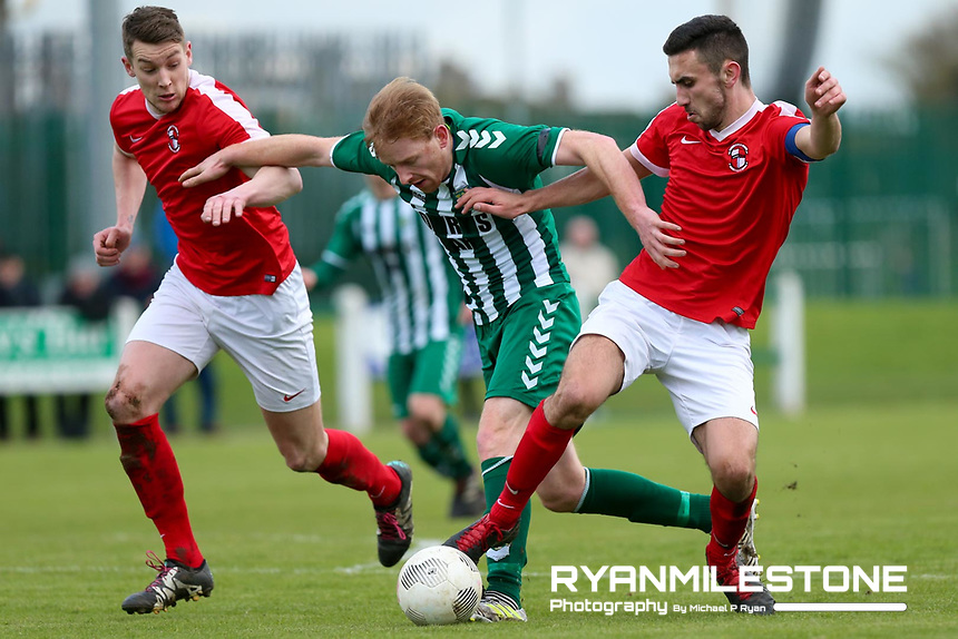 St Michael's John O' Brien in action against Sean Tierney and James Callen of Tolka Rovers during the New Balance FAI Junior Cup 7th Round at Cooke Park ,Tipperary Town on Sunday 4th February 2018, Photo By Michael P Ryan