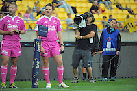 Match officials and Skysport staff wait for a TMO decision on Matt Proctor's try during the Super Rugby match between the Hurricanes and Cheetahs at Westpac Stadium, Wellington, New Zealand on Saturday, 15 March 2014. Photo: Dave Lintott / lintottphoto.co.nz