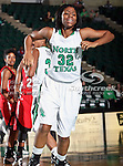 North Texas Mean Green guard Denetra Kellum (32) in action during the NCAA Women's basketball game between the Arkansas State Red Wolves and the University of North Texas Mean Green at the North Texas Coliseum,the Super Pit, in Denton, Texas. Arkansas State defeated UNT 62 to 59