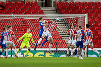 19th December 2020; Bet365 Stadium, Stoke, Staffordshire, England; English Football League Championship Football, Stoke City versus Blackburn Rovers; Harry Souttar of Stoke City heads the ball clear from his goalmouth