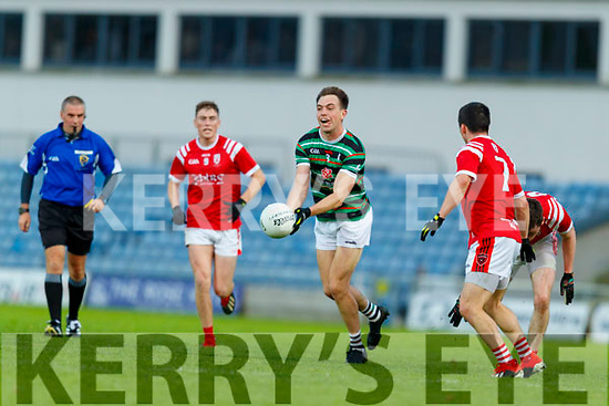Jack Barry, (Captain) St. Brendan's Board in action against Paul Murphy, East Kerry during the Kerry County Senior Football Championship Semi-Final match between East Kerry and St Brendan's at Austin Stack Park in Tralee, Kerry.