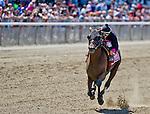 July 5, 2014: Kid Cruz, ridden by Irad Ortiz, Jr., wins the Dwyer Stakes on Belmont Derby Day at Belmont Park in Elmont, New York. Scott Serio/ESW/CSM