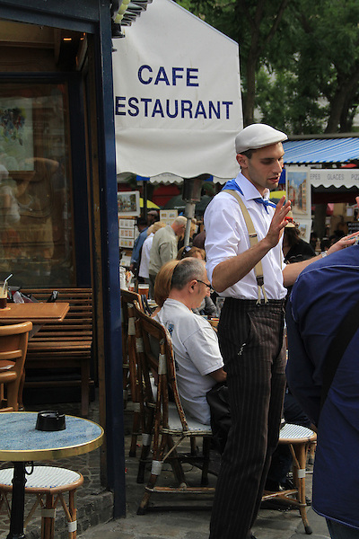 This waiter looked so French (iconic) I couldn't resist. Near the Sacre-Coeur Basilica in Montmartre, Paris, France.