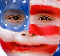 A young boy shows off his painted face at the annual Fourth of July Celebration and community parade in Birkdale Village in Huntersville, NC. Birkdale Village combines the best of shopping, dining, apartments and entertainment venues within a 52-acre mixed-use development.