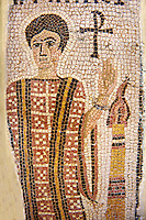 Detail of a fifth century AD Eastern Roman Byzantine  Christian  funerary mosaic of of a little girl The fragmentary inscription is at the top: (name of the deceased) who lived 4 years 11 months, 3 days 7 hours. The deceased is featured in a praying attitude, wearing an embroidered dalmatic. A monogrammed cross and a lit candle accompany the funerary idealised portrait. <br />