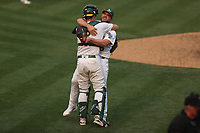 OAKLAND, CA - OCTOBER 1:  Liam Hendriks #16 of the Oakland Athletics celebrates with teammate Sean Murphy #12 after getting the last out against the Chicago Sox to win Wild Card Round Game Three and the payoff series at the Oakland Coliseum on Thursday, October 1, 2020 in Oakland, California. (Photo by Brad Mangin)