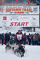 Rob Loveman team leaves the start line during the restart day of Iditarod 2009 in Willow, Alaska