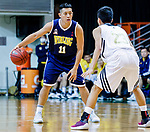 Poon Chi Ho #11 of Winling Basketball Club (L) dribbles the ball up court against Lui Ming In #23 of Eagle Basketball Team (R) during the Hong Kong Basketball League game between Eagle and Winling at Southorn Stadium on May 4, 2018 in Hong Kong. Photo by Yu Chun Christopher Wong / Power Sport Images