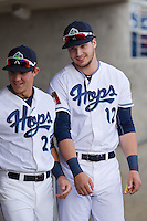 Grant Heyman (12) and Joey Armstrong (23) of the Hillsboro Hops prior to a game against the Tri-City Dust Devils at Ron Tonkin Field in Hillsboro, Oregon on August 24, 2015.  Tri-City defeated Hillsboro 5-1. (Ronnie Allen/Four Seam Images)