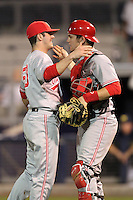 Ohio State Buckeyes pitcher Trace Dempsey #50 and catcher Greg Solomon #16 celebrate a win after a game against the Michigan Wolverines at the Charlotte County Sports Park on March 2, 2012 in Port Charlotte, Florida.  Ohio State defeated Michigan 9-4.  (Mike Janes/Four Seam Images)