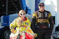 Nov. 11, 2012; Pomona, CA, USA: NHRA funny car driver Jeff Arend with his daughter Jenna Arend during the Auto Club Finals at at Auto Club Raceway at Pomona. Mandatory Credit: Mark J. Rebilas-