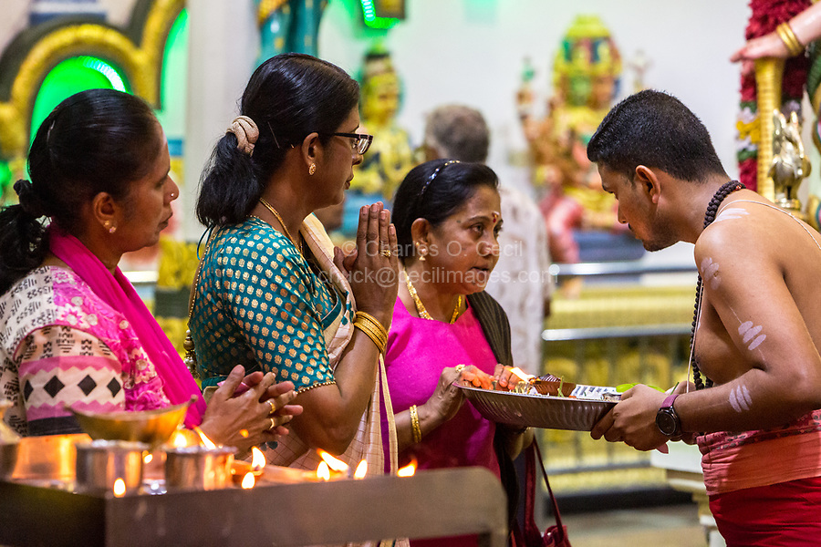 Hindu Temple, Sri Maha Mariamman, Priest and Worshipers during Navarathri Celebrations, George Town, Penang, Malaysia.