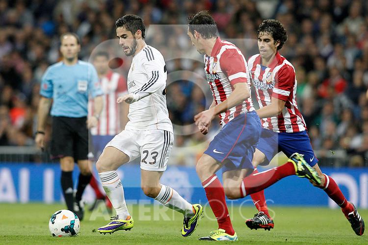 Real Madrid's Isco (l) and Atletico de Madrid's Tiago Cardoso (r) and Diego Godin during La Liga match.September 28,2013. (ALTERPHOTOS/Acero)