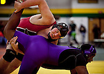 hamiltonp1 - Zach James of Marshall High School (top), takes down and beats Elliot Gillomm-Potecte (CQ) of Bradley Tech, in Milwaukee on Thursday, December 23, 2010. Photographed by MARK ABRAMSON/MABRAMSON@JOURNALSENTINEL.COM