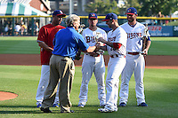 Buffalo Bisons pitcher Bobby Korecky (29) is presented the Warren Spahn Most Valuable Pitcher Awared as Raul Valdes, Ryan Schimpf, and Kyle Drabek look on during a ceremony before a game against the Pawtucket Red Sox on August 26, 2014 at Coca-Cola Field in Buffalo, New  York.  Pawtucket defeated Buffalo 9-3.  (Mike Janes/Four Seam Images)