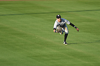 Tampa Yankees outfielder Jake Cave (18) makes a diving catch during a game against the Lakeland Flying Tigers on April 5, 2014 at Joker Marchant Stadium in Lakeland, Florida.  Lakeland defeated Tampa 3-0.  (Mike Janes/Four Seam Images)