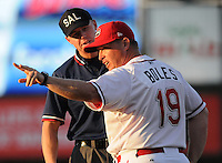 July 29, 2009: Manager Kevin Boles (19) of the Greenville Drive argues a call with umpire Chris Graham during a game at Fluor Field at the West End in Greenville, S.C. Photo by: Tom Priddy/Four Seam Images