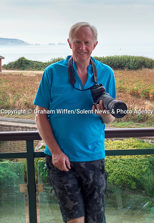 Pictured:  Graham Wiffen who took the photos<br /> <br /> A mysterious craft spotted flying through the skies last night left confused Britons arguing over what it might be - with some suggesting 'aliens'.  The 'UFO' could be seen flying vertically in orange sky at 8.45pm on Wednesday on the British coastline, leaving a long trail behind it before it rolled and 'disappeared' out of sight.<br /> <br /> The peculiar sight baffled people, with a group of astrophotographers guessing that it was a 'rocket taking off', a 'fighter aircraft' or a 'typhoon jet'.  Some even claimed it could be aliens - or Dr Who in a Tardis.  Retired salesman Graham Wiffen, who captured the shots from coastal village Milford-on-Sea, Hants, as he looked out across Dorset, thought he was witnessing a rocket.  SEE OUR COPY FOR DETAILS.<br /> <br /> Please byline: Graham Wiffen/Solent News<br /> <br /> © Graham Wiffen/Solent News & Photo Agency<br /> UK +44 (0) 2380 458800