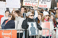 "People gather during the March For Our Lives protest and demonstration in Boston Common in Boston, Massachusetts, USA, on Sat., March 24, 2018. The march was held in response to recent school gun violence. Here signs read ""It's time to change,"" ""I don't want to be next"" and ""Enough. / Basta."""