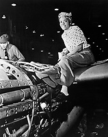 Riveter at Lockheed Aircraft Corp., Burbank, CA. (Women's Bureau)<br /> Exact Date Shot Unknown<br /> NARA FILE #:  086-WWT-3-67<br /> WAR & CONFLICT BOOK #:  804