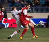 Harrison Shipp (10) of Notre Dame has the ball cleared away from him by Kyle Venter (12) of New Mexico during the NCAA Men's College Cup semifinals at PPL Park in Chester, PA.  Notre Dame defeated New Mexico, 2-0.