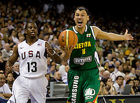 Lithuania guard (13) Sarunas Jasikevicius disputes a call while playing at the Cotai Arena inside the Venetian Macau Resort and Hotel.  The US defeated Lithuania, 120-84.
