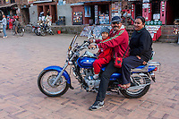 Bhaktapur, Nepal.  Christian Minister with Family on Motorcycle.