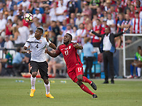 Commerce City, CO - Thursday June 08, 2017: Sheldon Bateau, Jozy Altidore during a 2018 FIFA World Cup Qualifying Final Round match between the men's national teams of the United States (USA) and Trinidad and Tobago (TRI) at Dick's Sporting Goods Park.