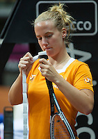 Arena Loire,  Trélazé,  France, 14 April, 2016, Semifinal FedCup, France-Netherlands, Dutch team warming up, Richel Hogenkamp puts a new grip on her racket<br /> Photo: Henk Koster/Tennisimages