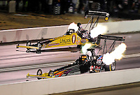 Jul. 24, 2009; Sonoma, CA, USA; NHRA top fuel dragster driver Mike Strasburg (near) races Clay Millican during qualifying for the Fram Autolite Nationals at Infineon Raceway. Mandatory Credit: Mark J. Rebilas-