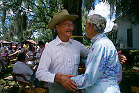 Family members greet one another at the Tatum family reunion where sometimes 1000 kin show up for the celebration.