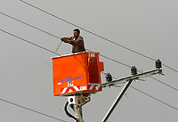 "Palestinain worker  fixing power line  after isreal withdrawal from gaza strip.March.03.2008.""phto by Fady Adwan"""
