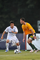 Jeff Cosgriff (yellow) AC St Louis, Takashi Hirano...AC St Louis and Vancouver Whitecaps played to a 0-0 tie at Anheuser-Busch Soccer Park, Fenton, Missouri.