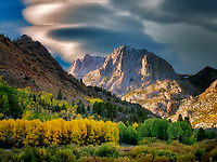 Aspen trees in fall color and mountains around June Lakes Loop.Eastern Sierra Nevada Mountains, California