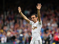 Pictured: Leon Britton of Swansea thanks away supporters<br /> Re: Premier League match between Crystal Palace and Swansea City at Selhurst Park on May 24, 2015 in London, England, UK