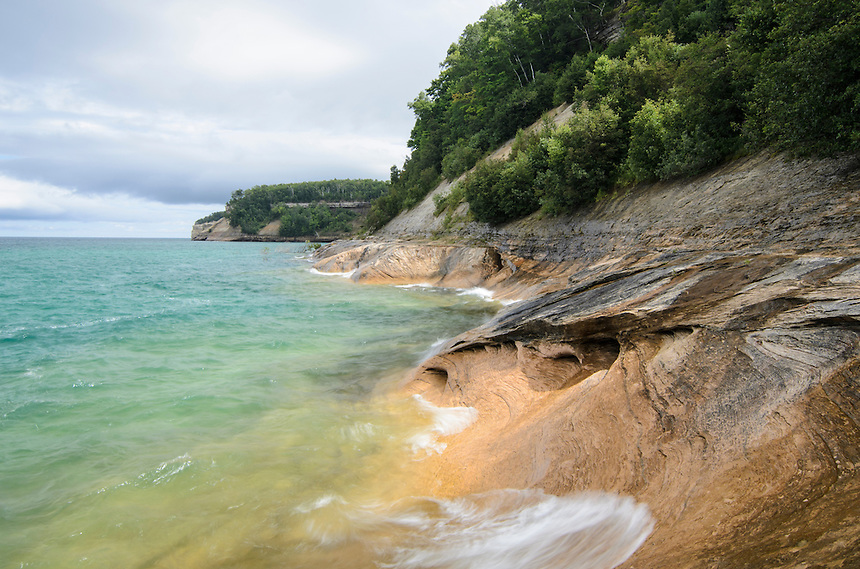 The beautiful clear water of Lake Superior splashing along the interesting shoreline of Pictured Rocks National Lakeshore. Munising, MI