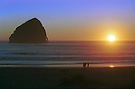 Sunset Haystack Rock 235 feet high monolith the sea stack Oregon coast, Haystack Rock, sea stack, intertidal, tide pools, starfish, anemone, crabs, chitons, limpets, sea slugs, sea birds, terns, puffins,  Canon Beach in Clatsop County, Pacific Ocean, Plains, woods, mountains, rain forest, desert, rain, Tolovana Beach Sate Recreation Site Refuge, Fine Art Photography by Ron Bennett, Fine Art, Fine Art photography, Art Photography, Copyright RonBennettPhotography.com ©