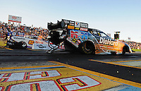 Sept. 23, 2011; Ennis, TX, USA: NHRA funny car driver Matt Hagan (near lane) races alongside Johnny Gray during qualifying for the Fall Nationals at the Texas Motorplex. Mandatory Credit: Mark J. Rebilas-
