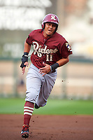 Frisco RoughRiders shortstop Edwin Garcia (11) running the bases during a game against the Springfield Cardinals on June 3, 2015 at Hammons Field in Springfield, Missouri.  Springfield defeated Frisco 7-2.  (Mike Janes/Four Seam Images)