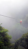 Boy riding zip-line in Coasta Rica