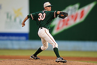 Greensboro Grasshoppers starting pitcher Andrew Heaney #30 delivers a pitch during game one of the South Atlantic League, Southern Division playoffs between the Greensboro Grasshoppers and the Asheville Tourists at McCormick Field on September 10, 2012 in Asheville, North Carolina . The Grasshoppers defeated the Tourists 6-3. (Tony Farlow/Four Seam Images).