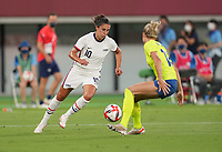 TOKYO, JAPAN - JULY 20: Carli Lloyd #10 of the United States moves with the ball during a game between Sweden and USWNT at Tokyo Stadium on July 20, 2021 in Tokyo, Japan.