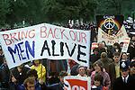 """Stop Falklands War London March 1982 """"Bring Back men Alive"""" banner."""